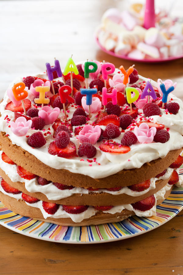 Happy birthday cake. Delicious cake with candy letters on top that read happy birthday royalty free stock images