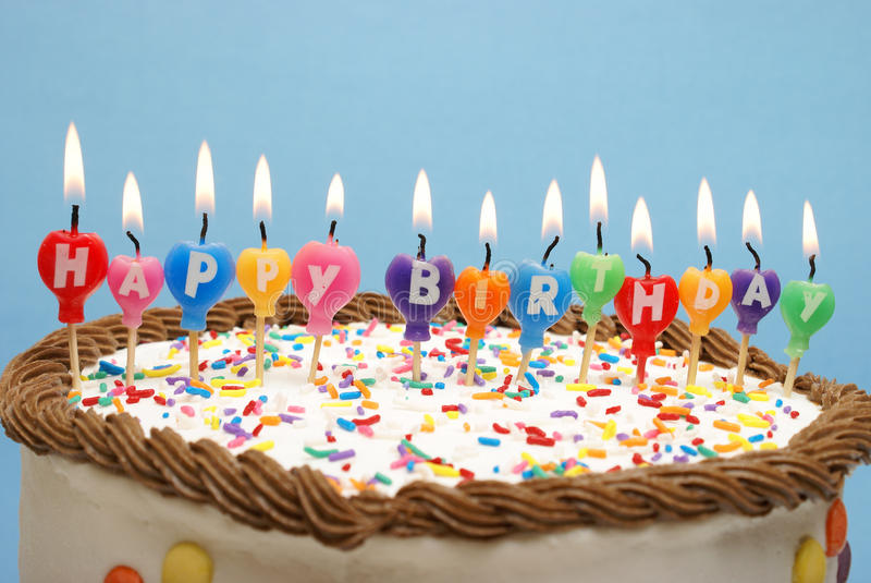 Happy Birthday Cake. A cake and it's candles that read happy birthday royalty free stock photography