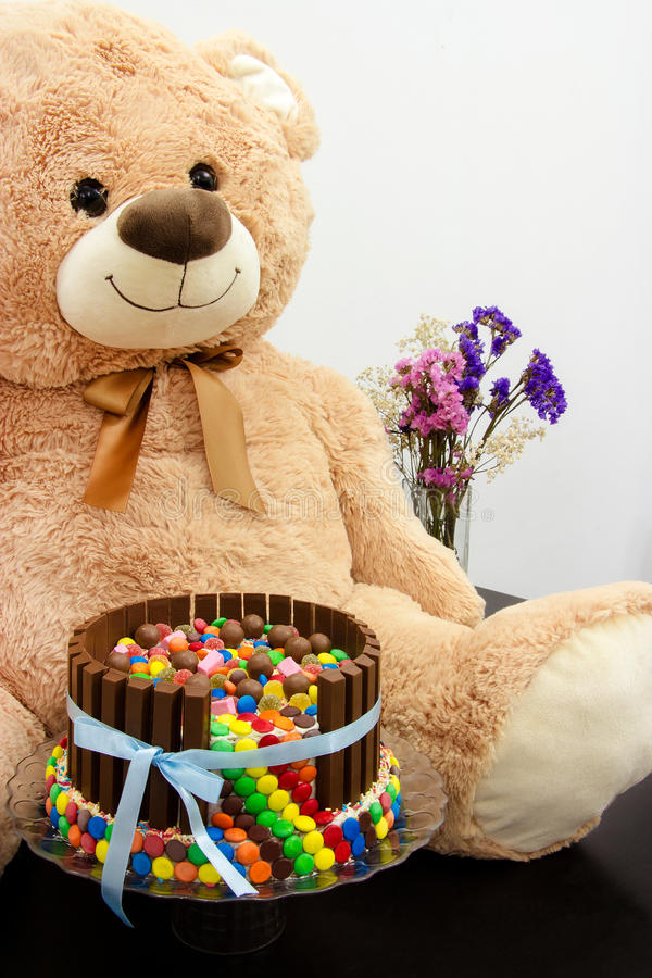 Happy birthday cake and big Teddy Bear. Festive tea party. Pinata Cake, a celebration cake with a hidden stash of sweets inside. stock image