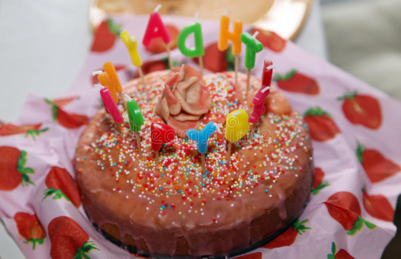 Happy Birthday Cake with Candles letter burning royalty free stock images