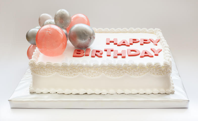 Happy Birthday Cake. Details of a happy birthday cake, on white background royalty free stock photo