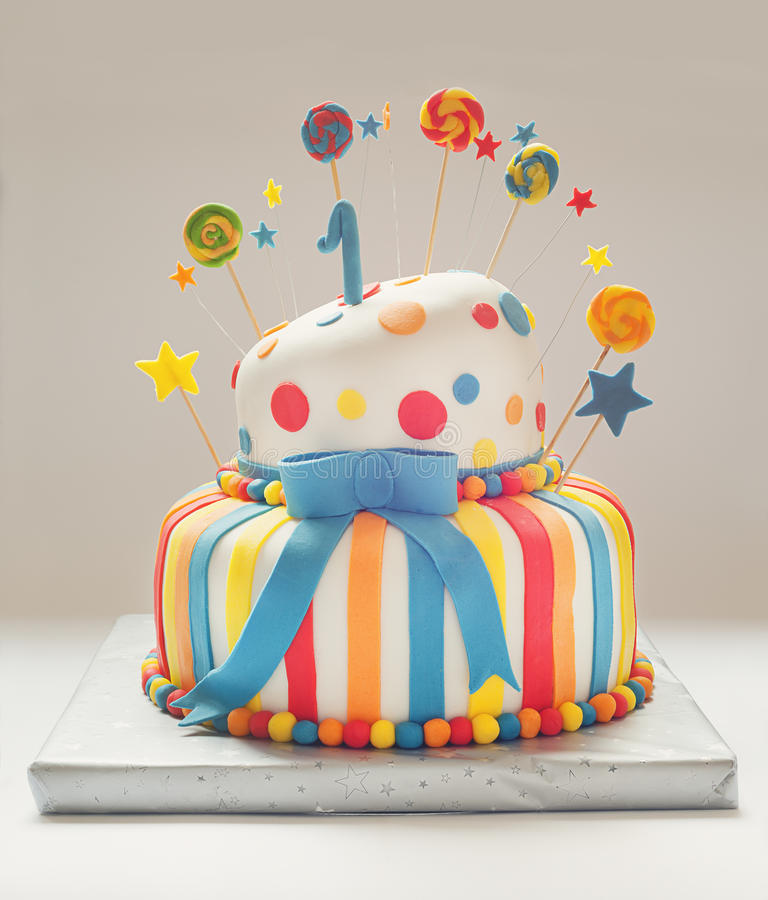 Happy Birthday Cake. Funny birthday cake with number one on top, sweet colorful decoration stock image