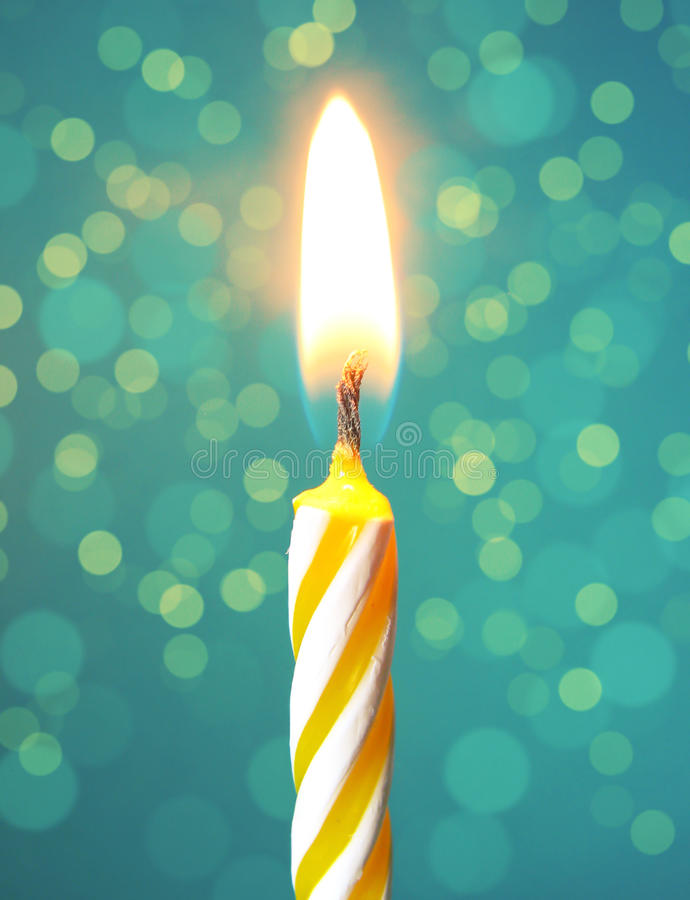 Happy birthday candle. On a bokeh background stock image