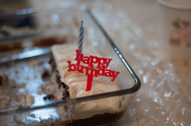 Happy Birthday Candle in Cake. Happy Birthday red candle Toy in chocolate cake. Candle in cake pan at Birthday Party stock photo