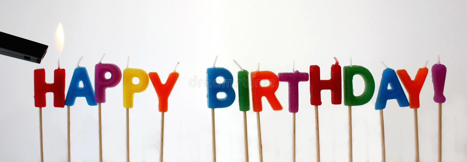 Happy Birthday Candles. Cute Happy Birthday candles being lit stock photo
