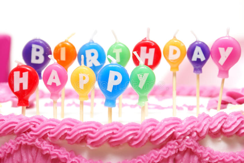 Happy Birthday Candles. Unlit candles that spell out happy birthday to celebrate someones special day stock image