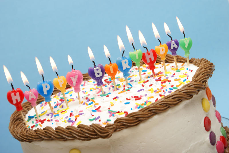 Happy Birthday Candles. A closeup of a cake and it's candles that read happy birthday royalty free stock images
