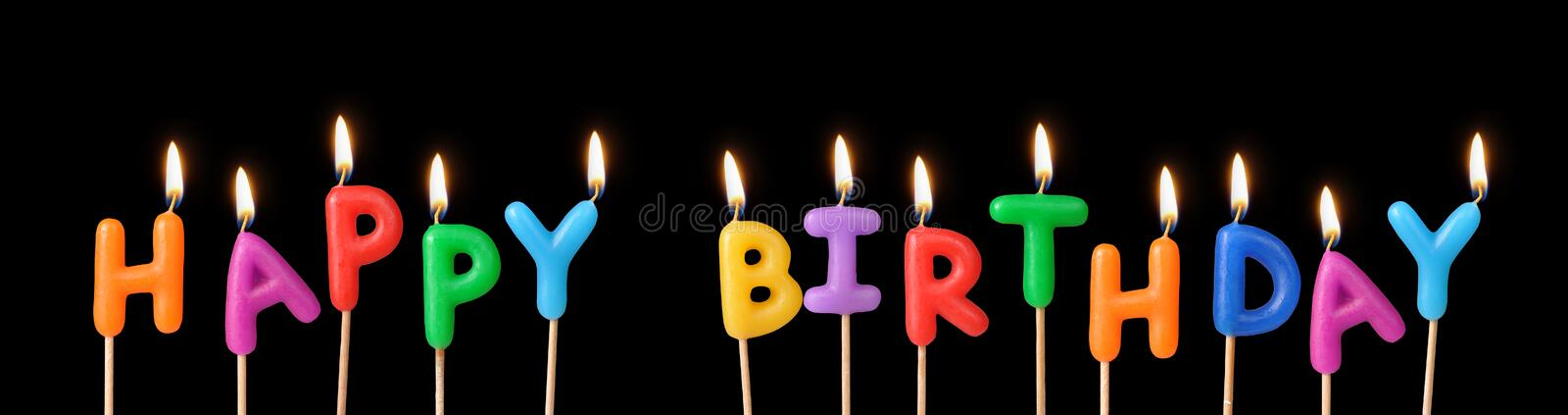 Happy birthday candles. A photo of happy birthday candles on black background stock photo