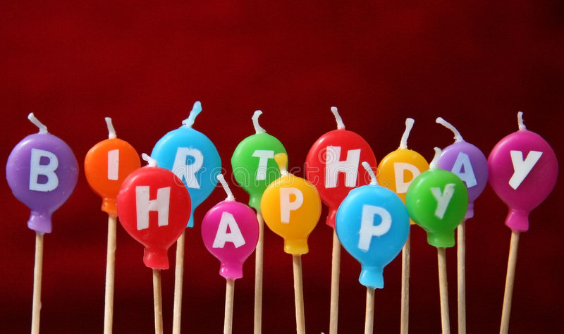Happy birthday candles. Funny colored happy birthday candles stock photos
