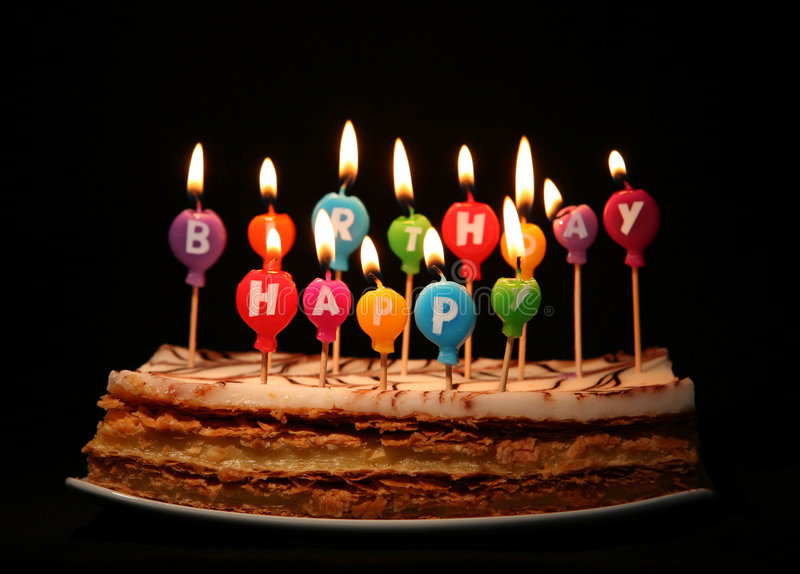 Happy birthday candles. On a cake royalty free stock image
