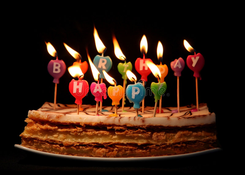 Happy birthday candles. On a cake stock photos