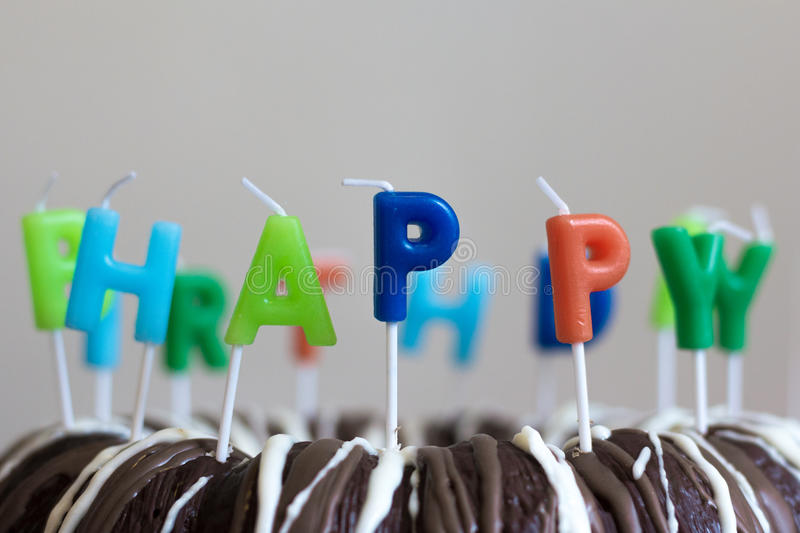 Happy Birthday Candles on chocolate cake royalty free stock images