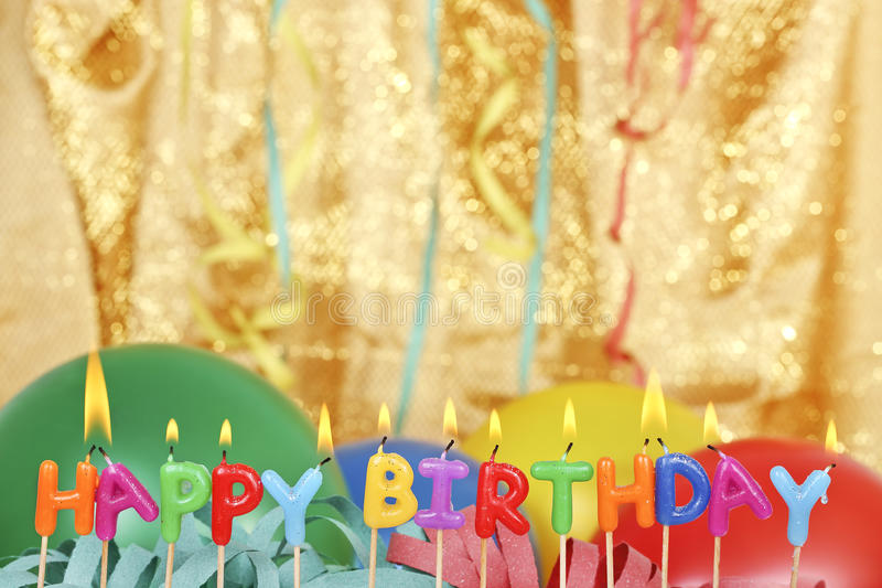 Happy birthday. Candles in front of party items royalty free stock photo