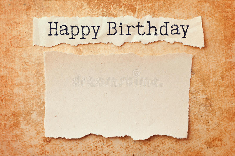 Happy birthday card. Paper with ripped edges on grunge paper background. Happy birthday royalty free stock photos