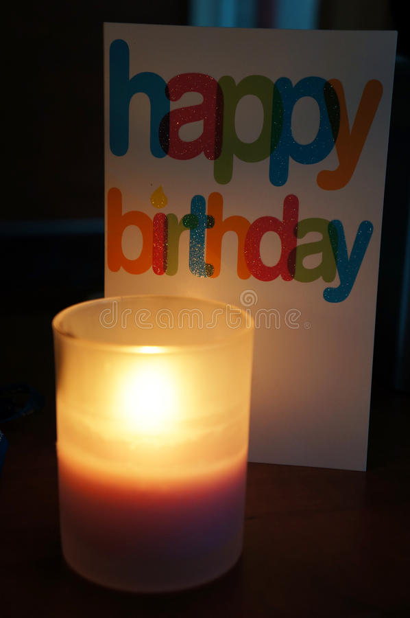 Happy birthday card. A candle and a happy birthday card royalty free stock images