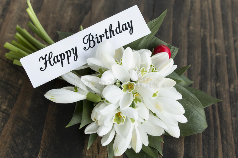 Happy Birthday Card with Bouquet of Snowdrops.  royalty free stock photos