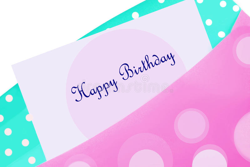 Happy birthday card in envelope. Happy Birthday card in pink and blue polkadot envelope stock photos
