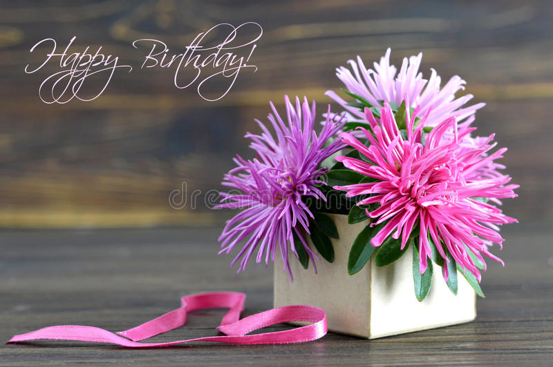 Happy Birthday card with flowers arranged in gift box. Wooden background stock images