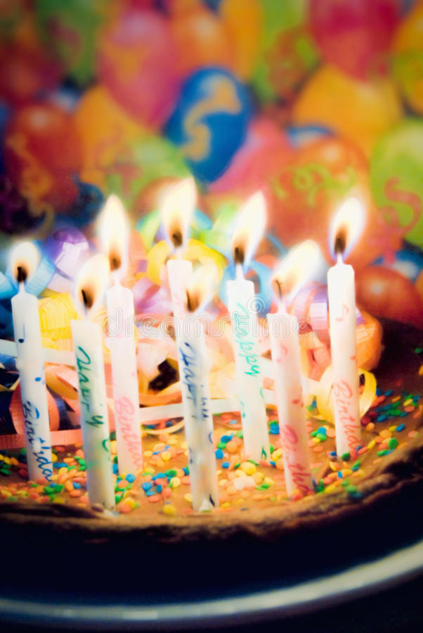 Happy Birthday Chocolate Cake with Burning Candles royalty free stock photography