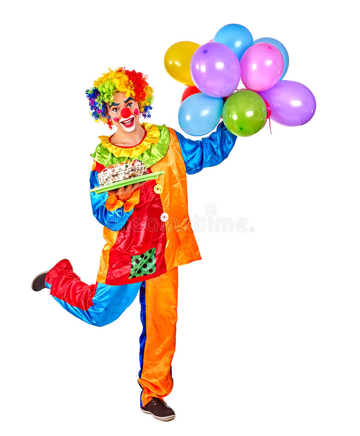 Happy birthday clown holding a bunch of balloons. Happy birthday clown man holding a bunch of balloons on Isolated stock photography