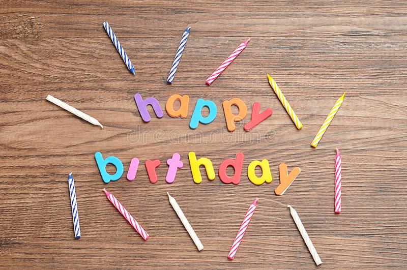 Happy birthday in colorful letters with a collection of birthday candles stock images