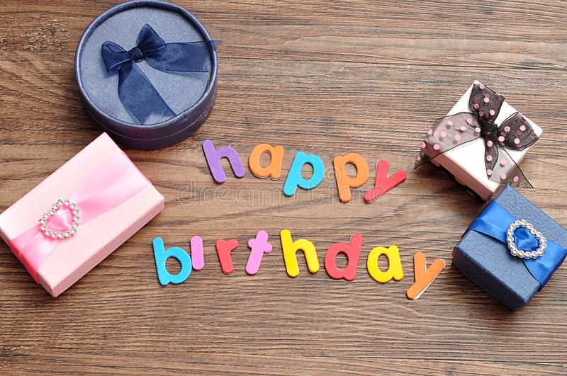 Happy birthday in colorful letters with a variety of gift royalty free stock photos