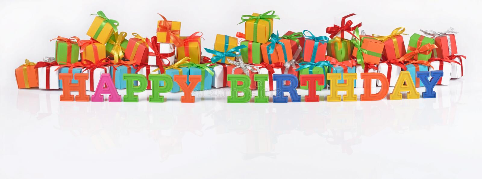 Happy birthday colorful text on the background of gifts. Happy birthday colorful text on the background of varicolored gifts royalty free stock image