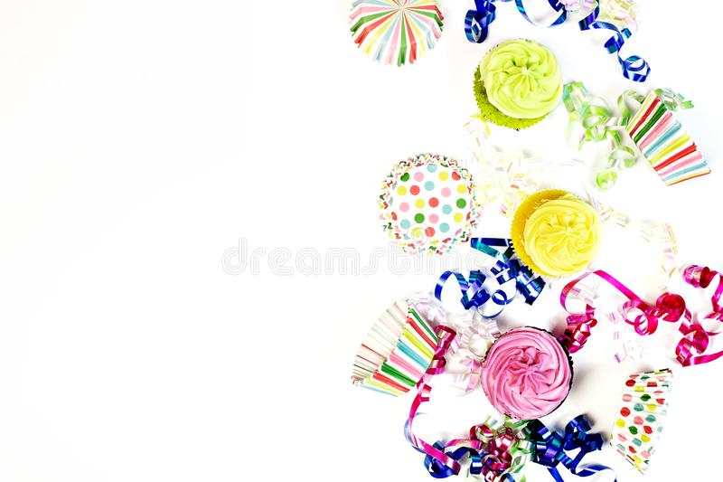 Happy birthday concept with copy space. Happy birthday concept bright colorful cupcakes with copy space on white background royalty free stock photo