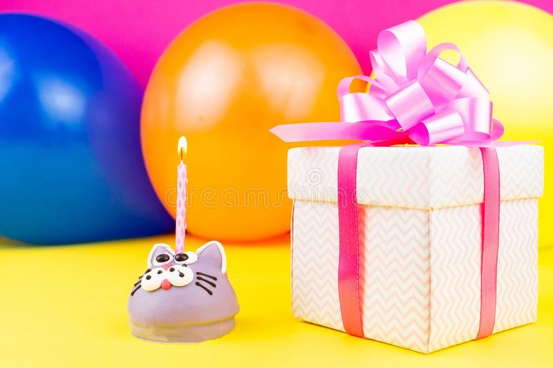 Concept happy birthday. Happy birthday concept with copy space, cake, gifts and caramel for birthday on yellow background stock image