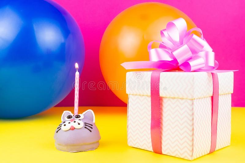 Concept happy birthday. Happy birthday concept with copy space, cake, gifts and caramel for birthday on yellow background stock photography