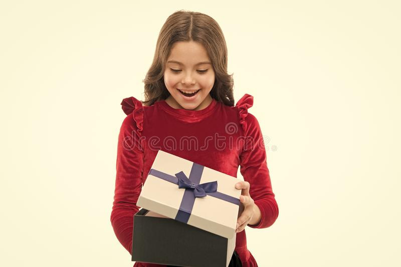 Happy birthday concept. Girl kid hold birthday gift box. Every girl dream about such surprise. Feel so thankful. Birthday girl carry present with ribbon bow royalty free stock images
