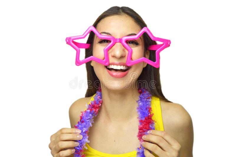 Happy birthday concept. Smiling girl with big star glasses and garland in birthday or carnival party isolated on white background. royalty free stock image