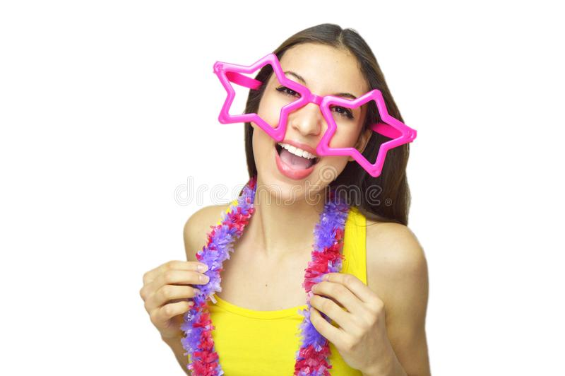Happy birthday concept. Young woman with big star glasses and garland dancing in birthday or carnival party isolated on white back royalty free stock images