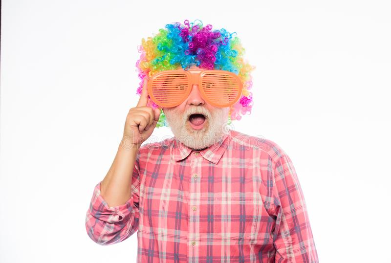 Happy birthday. corporate party. anniversary holiday. mature bearded man in colorful wig and party glasses. happy man. With beard. Celebration retirement. Crazy royalty free stock photography