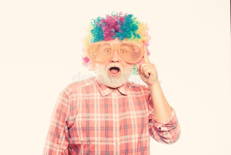 Happy birthday. corporate party. anniversary holiday. mature bearded man in colorful wig and party glasses. happy man royalty free stock photos