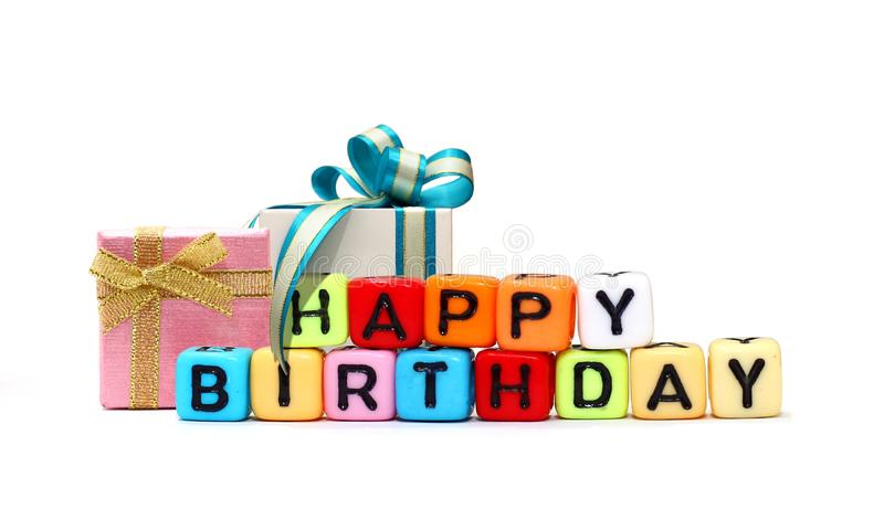 Happy Birthday cube text and gift boxes stock photos
