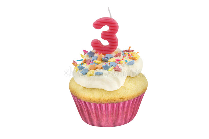 Happy birthday cup cake with star sprinkles and number 3 pink ca. Ndle on white table with pink background - Birthday celebration background for a little girl stock photo