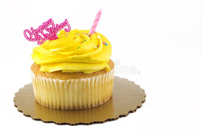 Happy Birthday Cupcake. A yellow Happy Birthday cupcake with one unlit pink candle and birthday message, isolated on white with copy space stock images