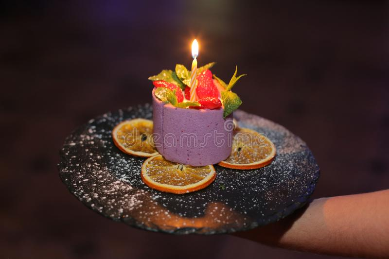 Happy birthday. Cupcake with burning candle. On plate stock photography