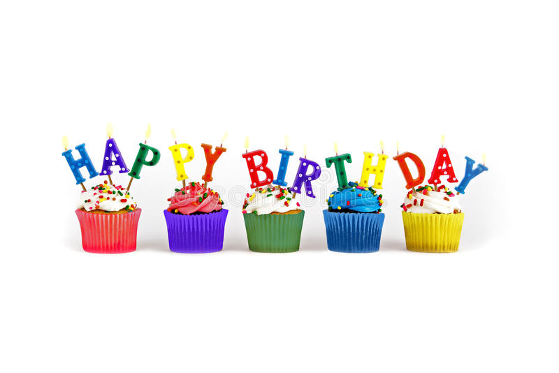 Happy Birthday cupcakes and candles. Colorful cupcakes with Happy Birthday candles stock photo