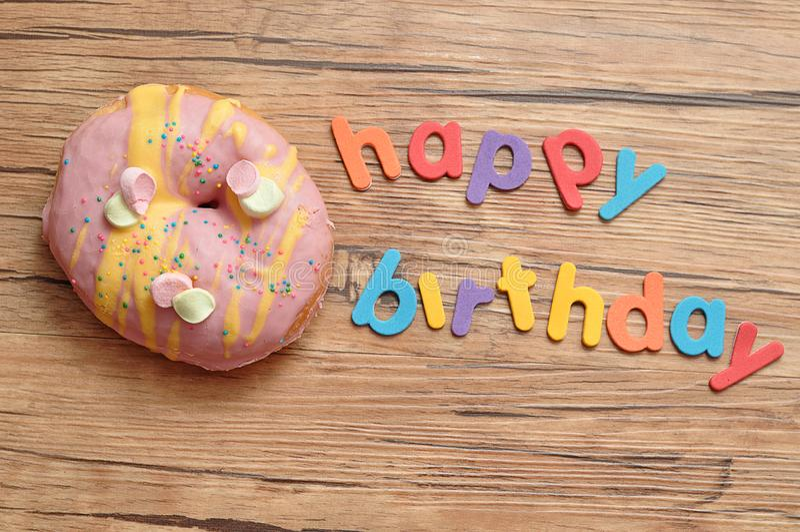 Happy birthday with a doughnut stock image