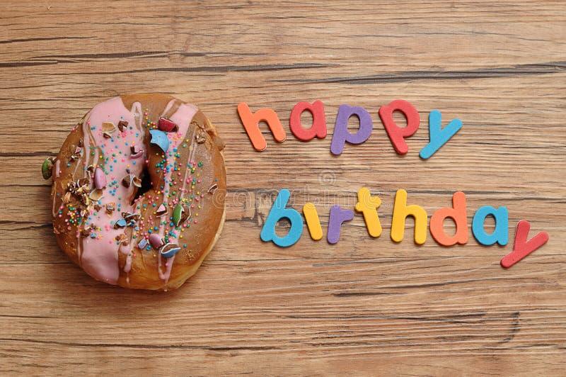 Happy birthday with a doughnut royalty free stock photos