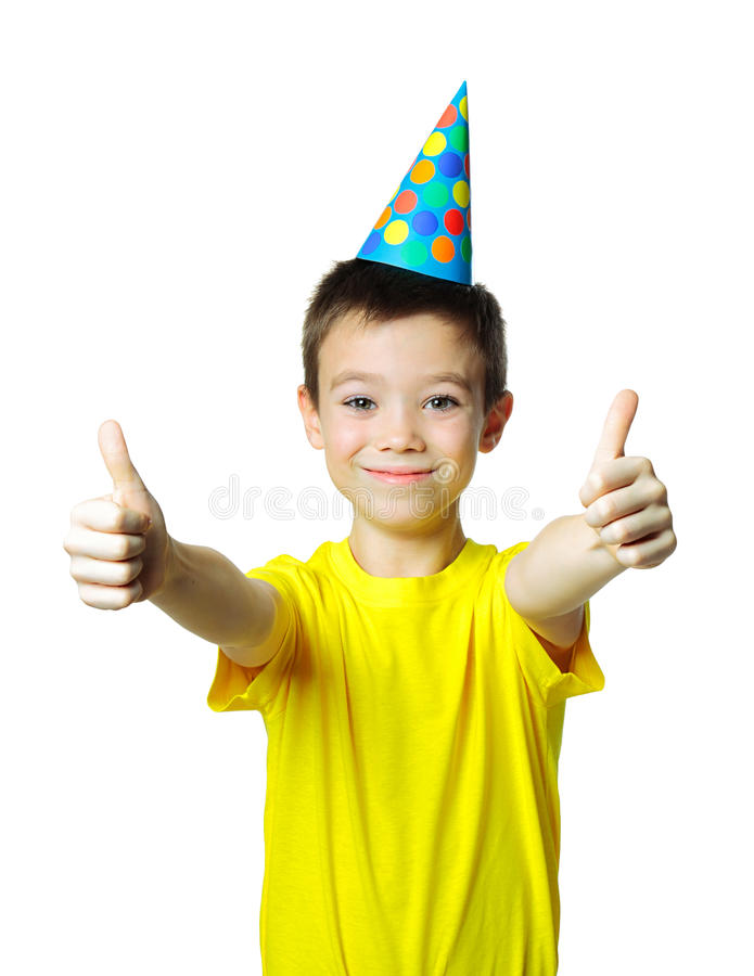 Happy birthday. Eight years boy with birthday cap showing thumbs up on white background stock image