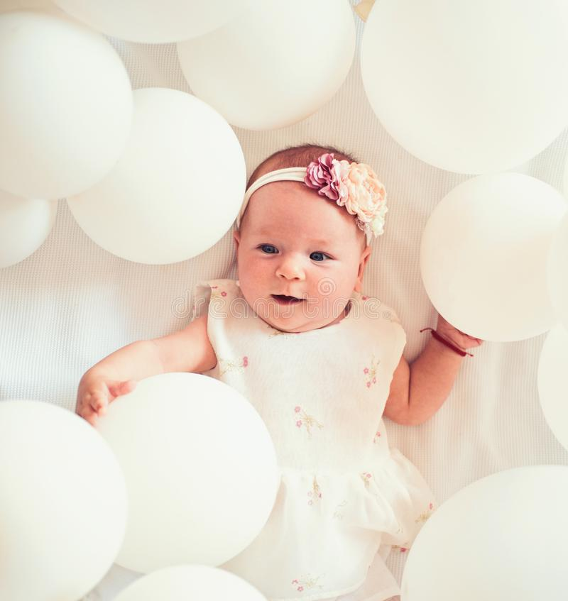 Happy birthday. Family. Child care. Childrens day. Small girl. Happy birthday. Portrait of happy little child in white. Balloons. Childhood happiness. Sweet stock image