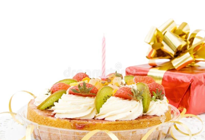 Happy Birthday - festive cake. Happy Birthday - festive strawberry cake and gifts. Isolated over white background stock photo