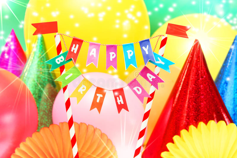 Happy Birthday. Flag, balloons and party hats royalty free stock photos