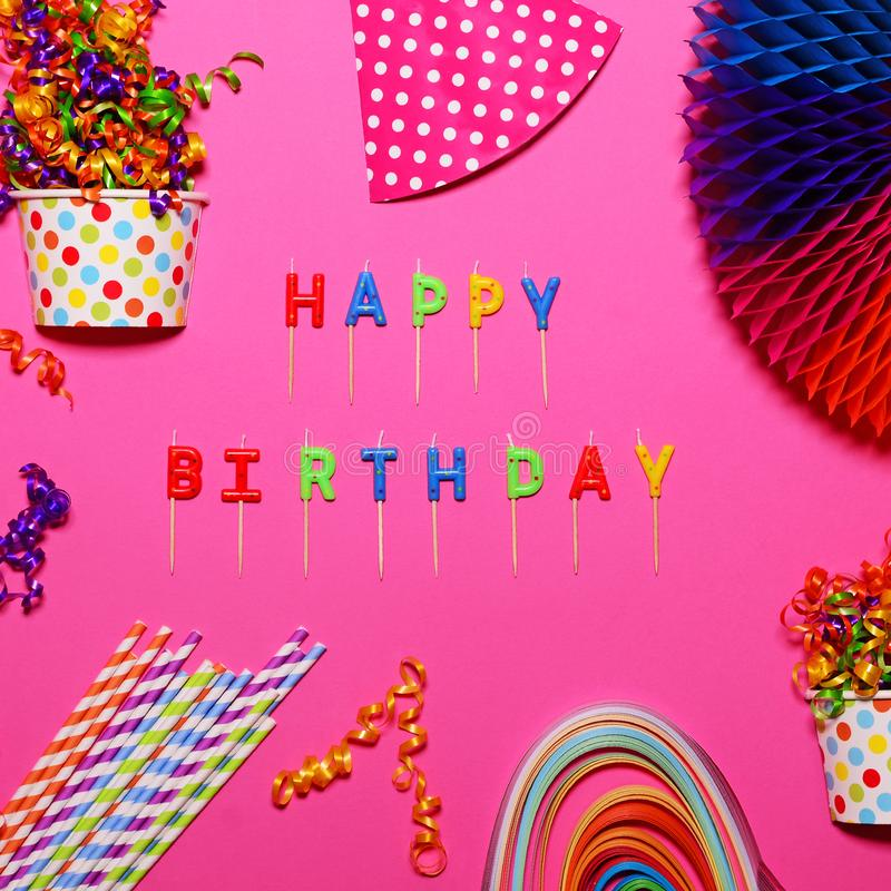 Happy Birthday flat lay with party decorations on pink background royalty free stock images
