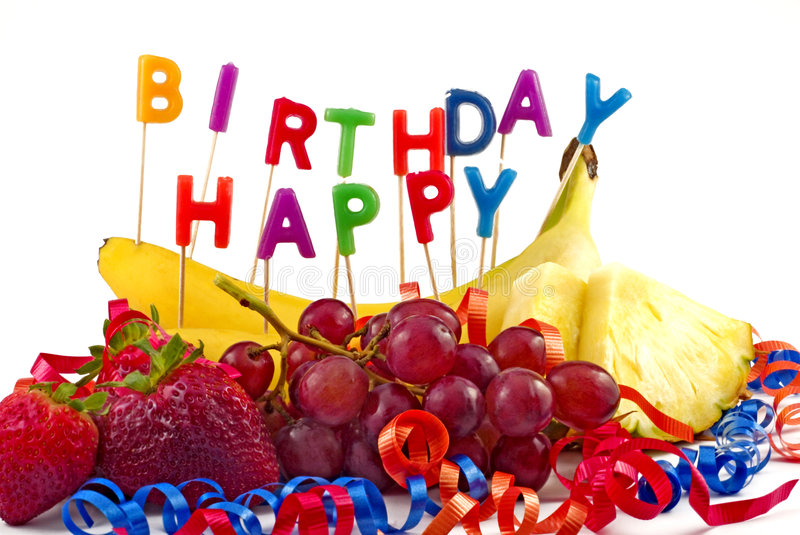 Happy Birthday Fruit. A collection of fresh fruit with Happy Birthday Candles for the healthy lifestyle Birthday Party copy space royalty free stock photography