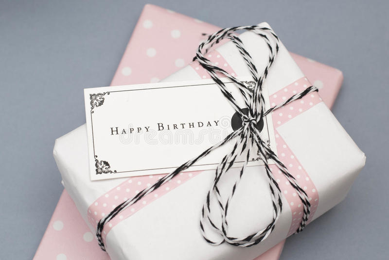 Happy birthday. Birthday gift decorated with paper tag and twine royalty free stock photo