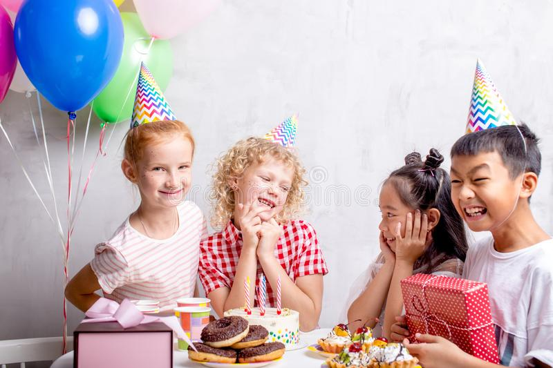 Happy birthday girl shares with her happiness with close friends. Celebration concept royalty free stock photo